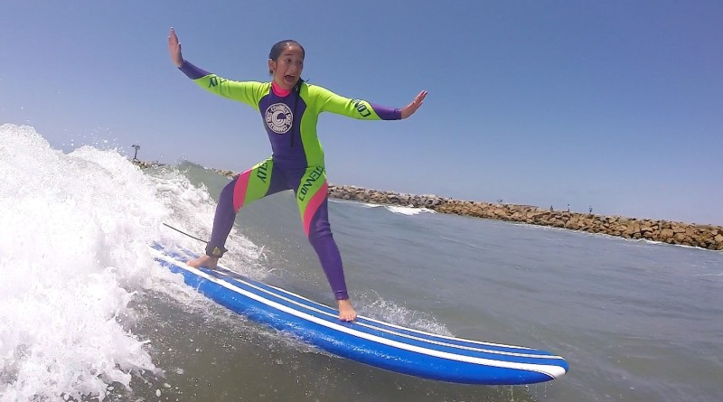 French Canadian Schoolgirl, Malika, charging on Day One at the San Diego Surfing Academy in her fantastic thrift store wetsuit on Mothers' Day 2015.