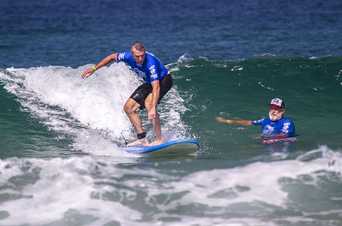 Team USA's first-ever Blind Surfer, Scott Leason, with Coach Pat Weber of the San Diego Surfing Academy at the first-ever ISA World Adaptive Games, La Jolla, CA, 2015.