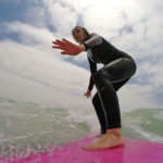 Villa Park Surf Club's Grace on Day One with Coach Pat Weber of the San Diego Surfing Academy