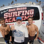 Vista Water Polo Players, Trent and Matthew, sharpen their surf skills with Coach Pat Weber of the San Diego Surfing Academy at Oceanside Harbor.