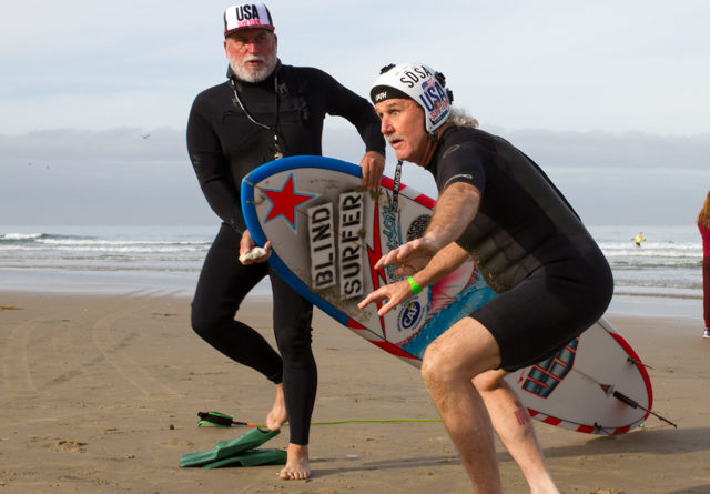 Coach Pat Weber of the San Diego Surfing Academy trains US Sight Impaired Surf Champ, Scott Leason.  Photo: ISA - Reynolds