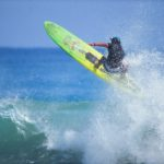 San Diego Surfing Academy Instructor Chris Olivas ignoring the gravity of the situation.  Randy Dible photo